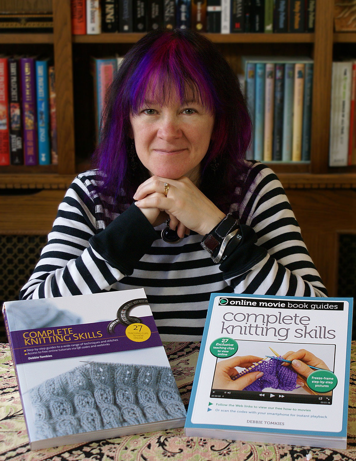 Debbie Tomkies with copies of her book Complete Knitting Skills